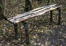Bench in forest. A rough wooden bench in the forest Royalty Free Stock Image