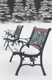 Bench. Forged bench standing on the street under the snow Royalty Free Stock Photos