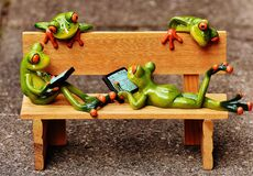 Bench with frogs Royalty Free Stock Photography