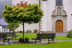 Bench in front of the church. Stock Images