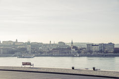 Bench in front of Danube river Stock Images
