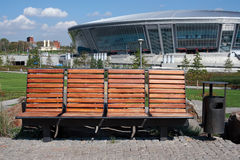 Bench in front of Donbass Arena royalty free stock image