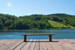 Bench in front of the lake Stock Photography