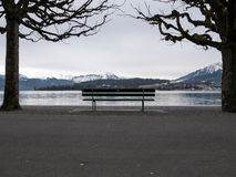 Bench in front of lake. A bench next to the lake in Luzern Royalty Free Stock Image