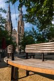 Bench in front of Saint Catherine`s Cathedral church in Eindhoven, Netherlands. Wooden Bench in front of Saint Catherine`s Cathedral church in Eindhoven royalty free stock images