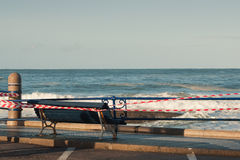 Bench in front of the sea, with big waves Stock Photos
