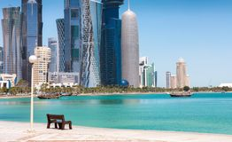 A bench in front of the Skyline of Doha Royalty Free Stock Photo