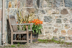 Bench in front of stone wall Royalty Free Stock Photos