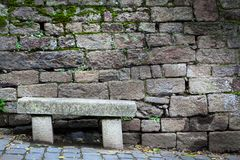 Bench in front of a stone wall, Dinan, Cotes-D'Armor, Brittany,. France Royalty Free Stock Image