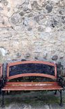 bench in front of a stone wall Royalty Free Stock Photography