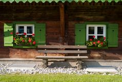 Bench on the Porch of a Traditional Austrian Wood House stock images