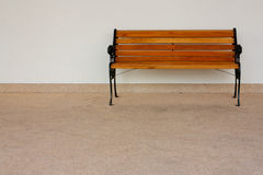 Bench front wall Royalty Free Stock Image