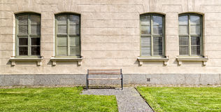 Bench in front of Windows Stock Photos