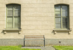 Bench in front of Windows Royalty Free Stock Photos