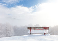 Bench in front of winter landscape Royalty Free Stock Images