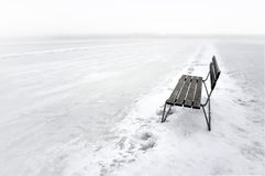 Bench on frozen lake Stock Photo