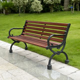 Bench in garden. A romantic bench in peaceful garden of residence Royalty Free Stock Photos