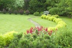 Bench in the garden royalty free stock photos