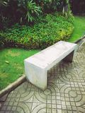 A bench in the garden. Mortar grey bench in the garden Stock Image