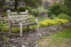 Bench in gardens at Wells Cathedral Royalty Free Stock Photo