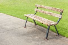 Bench in Golf Course. Bench on Concrete Cart Part in Golf Course Royalty Free Stock Photo