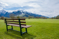 Bench on golf course royalty free stock photography