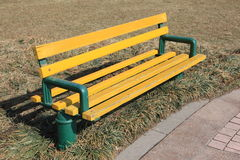 A bench on the grass stock images