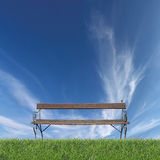 Bench on grass Stock Image