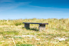 Bench in grass Stock Photos
