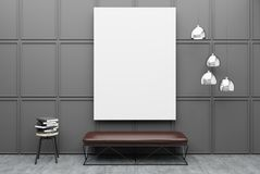 Bench in a gray room with a poster. Empty room interior with a gray wall, a concrete floor and a soft leather bench standing under a poster. 3d rendering mock up Royalty Free Stock Photo