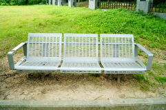 Bench in the green belt Stock Photography