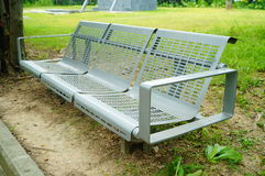 Bench in the green belt Royalty Free Stock Photography