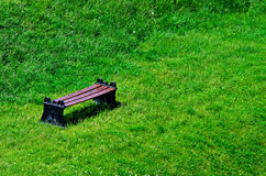 Bench on green grass Stock Photos