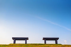 Bench on green grass Royalty Free Stock Photo