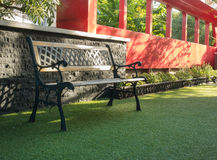 Bench in green grass Royalty Free Stock Image