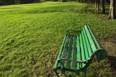 Bench 01. Bench on green grass in the Park Stock Photography