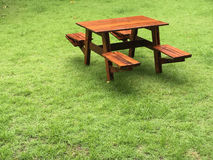Bench on the green grass Royalty Free Stock Photo