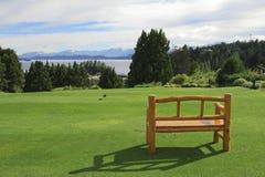 Bench on a green lawn Stock Photos