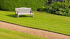 Bench on a green lawn Stock Images
