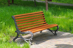 Bench and green lawn Stock Image