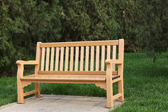 Bench in a green park Royalty Free Stock Image