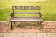 Bench is in a  green park. The bench stainless in garden it build Royalty Free Stock Photos
