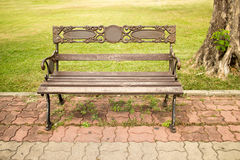 Bench is in a  green park. The bench stainless in garden it build Stock Photo