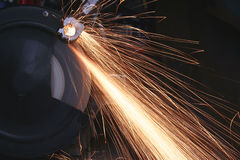 Bench grinder. In operation and emitting sparks Stock Photo