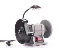 Bench grinder with lamp isolated on white. Background Stock Photos