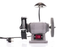 Bench grinder with lamp isolated on white Royalty Free Stock Photo