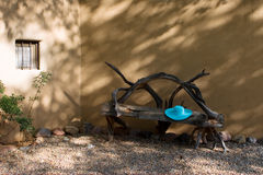 Bench and a hat. Blue hat ona southwestern bench Royalty Free Stock Photography