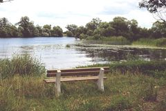 Bench at Havel river landscape at summer time (Havelland, German Royalty Free Stock Images