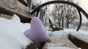 Bench with heart in winter park. Valentines day or Love winter idea. stock video