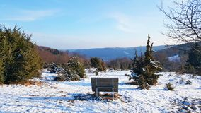 Bench on hill for enjoying beautiful view of nature. Baden-Wurttemberg at winter Royalty Free Stock Images